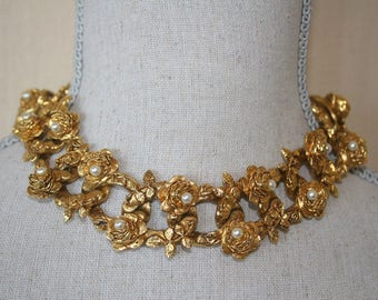 Gold evening necklace