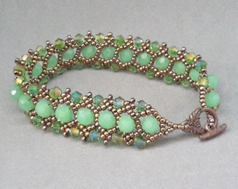 "7"" green glass round, crystals, bronze seed beads bracelet w copper toggle clasp, woven by Beaded by Lijana, Parisian Lights by Jill Wiseman"