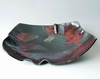 Large burgundy raku bowl
