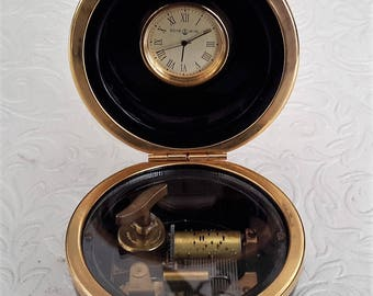 Reuge Music box, and clock, sphere shaped pot with a Reuge musical movement and a Reuge clock inside. Black and Gold.