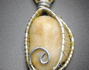 Semi-precious stone encased in yellow