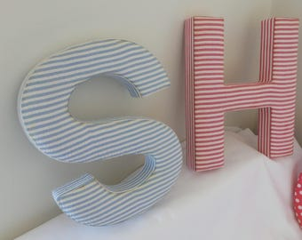 Fabric Letters SHOP hanging on wall of shop