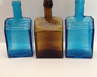 Group of E.C.Booz's Old Cabin Whiskey Bottles