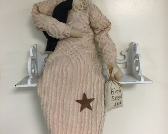 Handmade Primitive doll, peach chenille dress, blonde hair, holding black crow, rusted star on dress