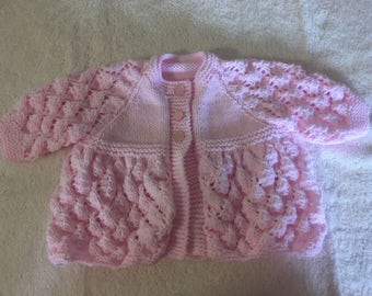 Handknitted baby cardigan