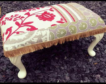 Upcycled Footstool with cream painted legs and patchwork effect fabric.