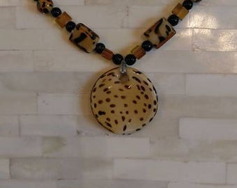 Long jungle themed necklace with lobster claw clasp and animal print pendant