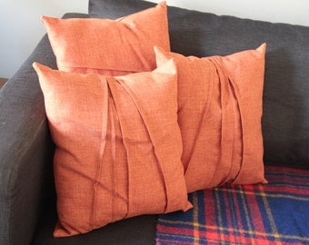 Hand made pleated throw pillows in sienna/burnt orange