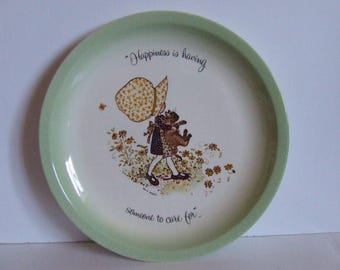 Retro Holly Hobbie collectible decorative ceramic plate girl in brown carrying brown cat green white Happiness is having someone to care for