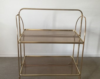 70s Dinett trolley, brass-coloured with plastic trays