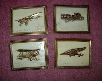 set of 4 early aviation plaques