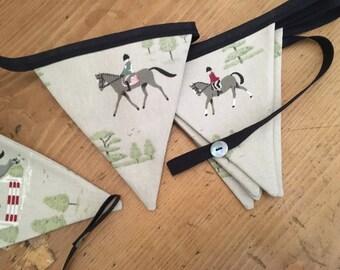 Handmade  bunting, in Soohie Allport Horses fabric.