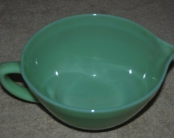 Fire King Jade-ite mixing bowl with handle and pouring sprout.