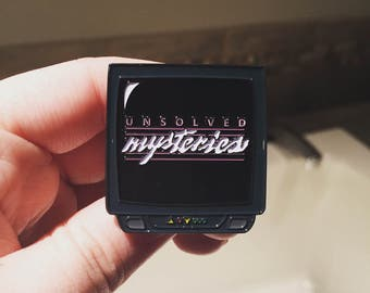 Unsolved Mysteries TV Enamel Pin
