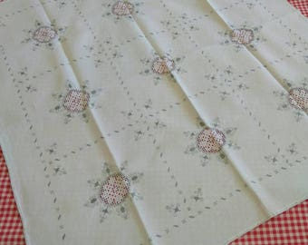 Vintage hand-embroidered Bulgarian tablecloth. Grey on white.