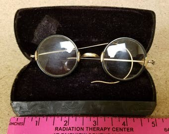Vintage wire rimmed eye glasses with case