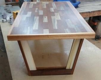 Butcher block inspired coffee table made from Brazilian mahogany, poplar and oak.