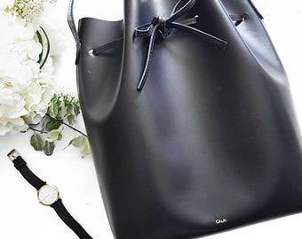 Minimalist leather bucket bag