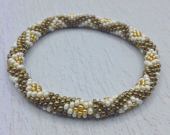 Nepal Bracelet. Beaded Bracelet Handmade by Ramila Beads, Brown, Gold and White. Hippie Bracelets.
