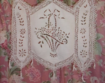 A pretty little embroidered vintage curtain