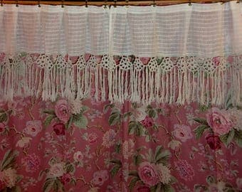 A pair of old fabric curtains and antique lace
