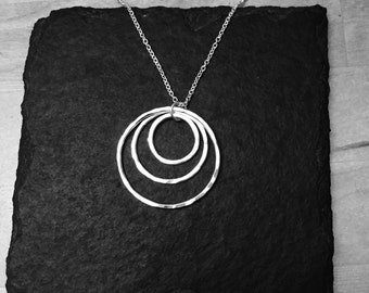Sterling silver nesting circles, hammered effect pendant