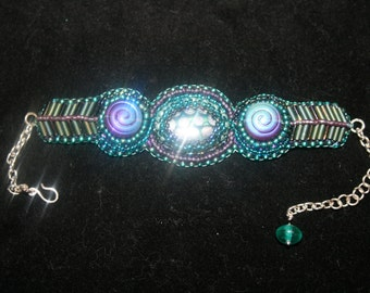 Turquoise and purple bead embroidered bracelet