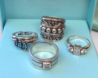Four Very Pretty Hallmarked Silver Rings.