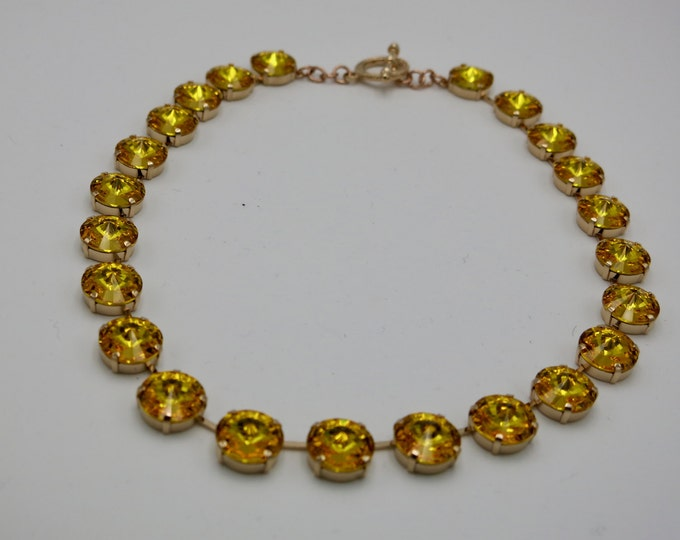 14mm Large Swarovski stones. Have all eyes on you in this eye-catching sunflower Swarovski crystal rivoli collar necklace.