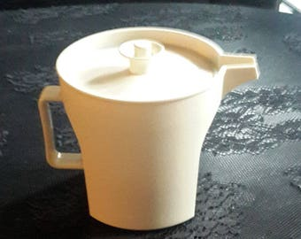 Tupperware sealing creamer container off white almond
