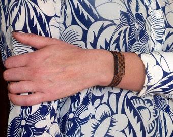 """Nboum"" two-tone braided leather bracelet"