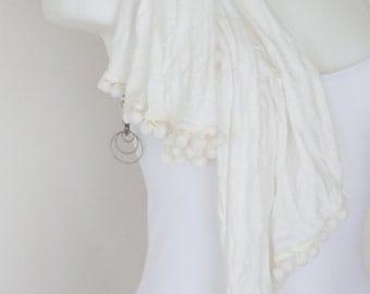 White scarf with pom poms