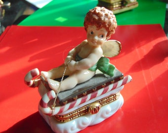 Large CUPID riding a Christmas Sled Musical trinket box by Music  Box  Co.