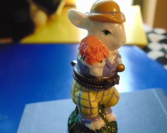 Easter Bunny with a derby hat and roses made by Midwest of Cannon Falls trinket inside is a large painted Easter Egg.