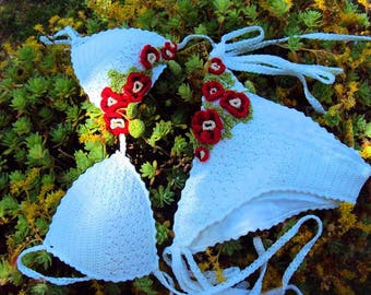 White swimsuit with red flowers.