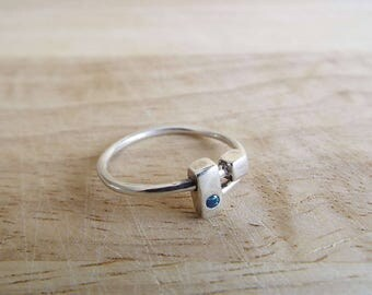 Adjustable Silver Ring set with Blue Cubic Zirconia. Multi-size. Handmade. Free delivery in the UK.