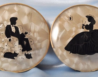 Two Matched Vintage Silhouette Round Dome Art. Peter Watson Studios.