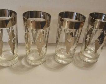 Set of four vintage silver rimmed high ball glasses with fleur-de-lis design