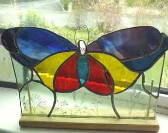 Glass butterfly on stand