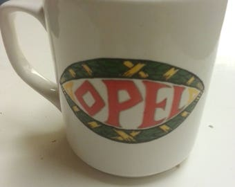 Handpainted Mug with the old OPEL-logo 9 cm high