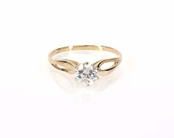 Round Brilliant Solitaire Diamond Engagement Ring in 14K Yellow Gold With 0.60 CTW Natural