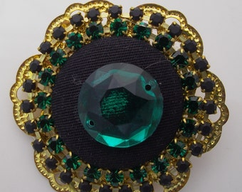 Button brooch and rhinestones