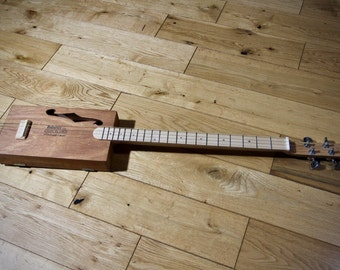 Handcrafted Cigar Box 4-string Guitar. Handmade piezo pickups.