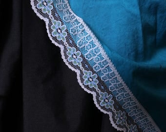 Aqua blue bustle with white lace and blue flowers