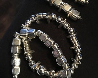 This fine silver (fine silver is 99.9% silver) Mykonos two bracelet and earring set is made with hand-formed fine Silverplated beads