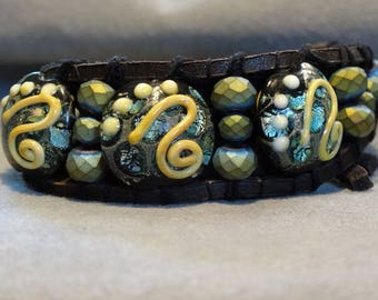 Black and gold lampwork leather wrap bracelet with Czech beads