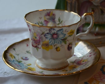 """English Bone China """"Elizabethan"""" floral Cup and Saucer"""