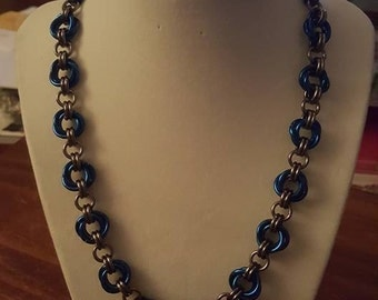 The Rose necklace in Blue and Black Ice