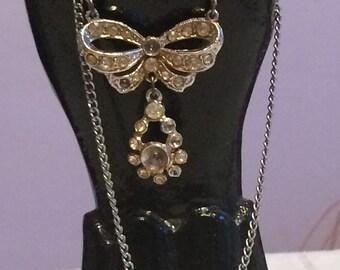 Silvertone RibbOn and Rhinestone Necklace