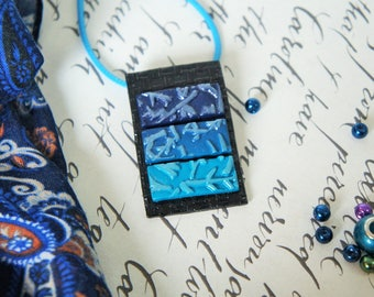 Japanese or Asian woman rectangle pendant necklace black and blue